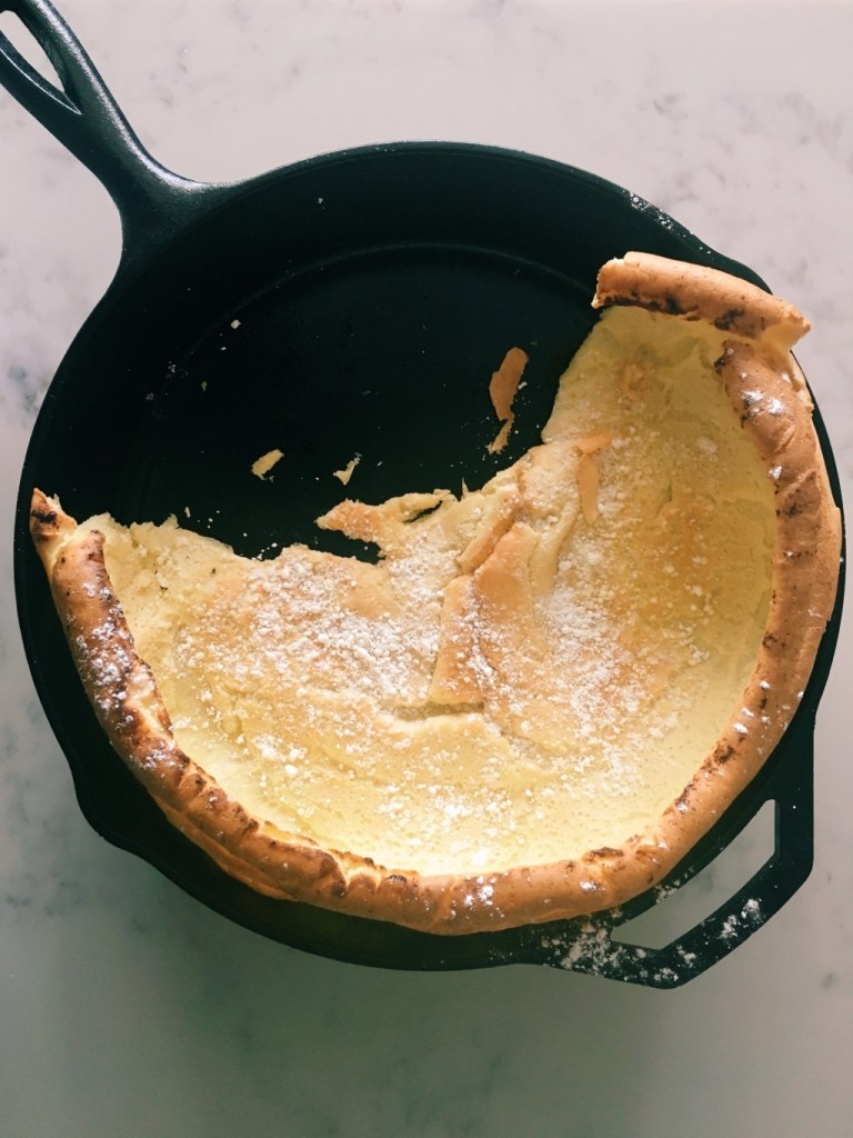 Cravings cookbook | Dutch Baby pancake in cast iron pan with serving removed | foodwithaview.com