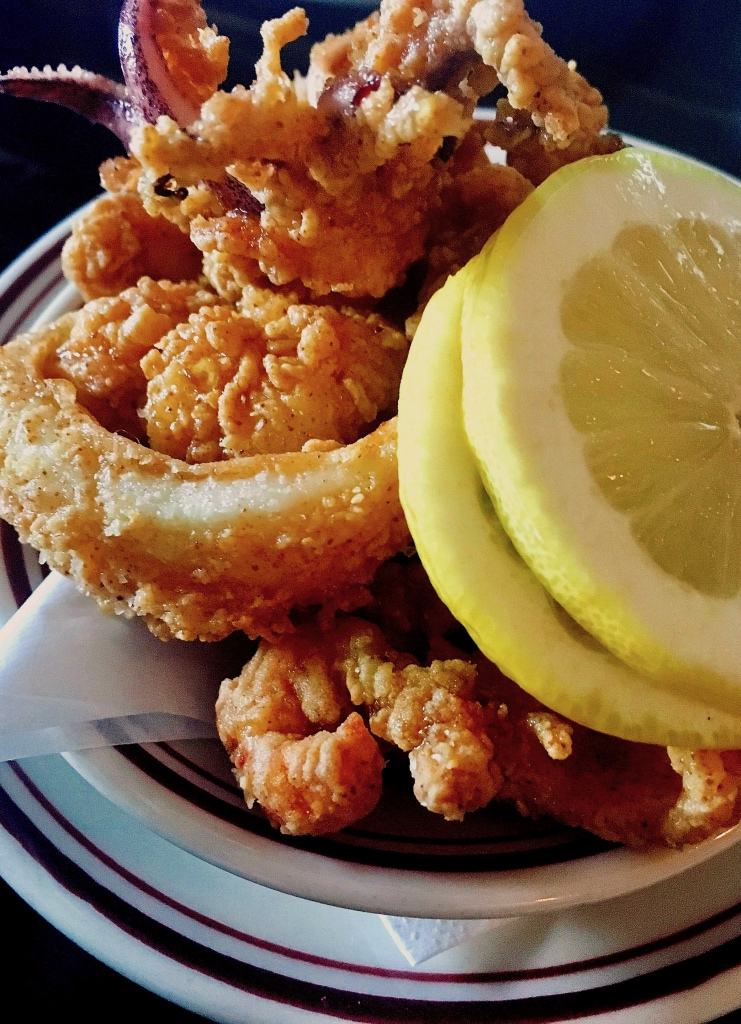 Golden fried calamari with fresh lemon slices | 100 Steps on foodwithaview.com