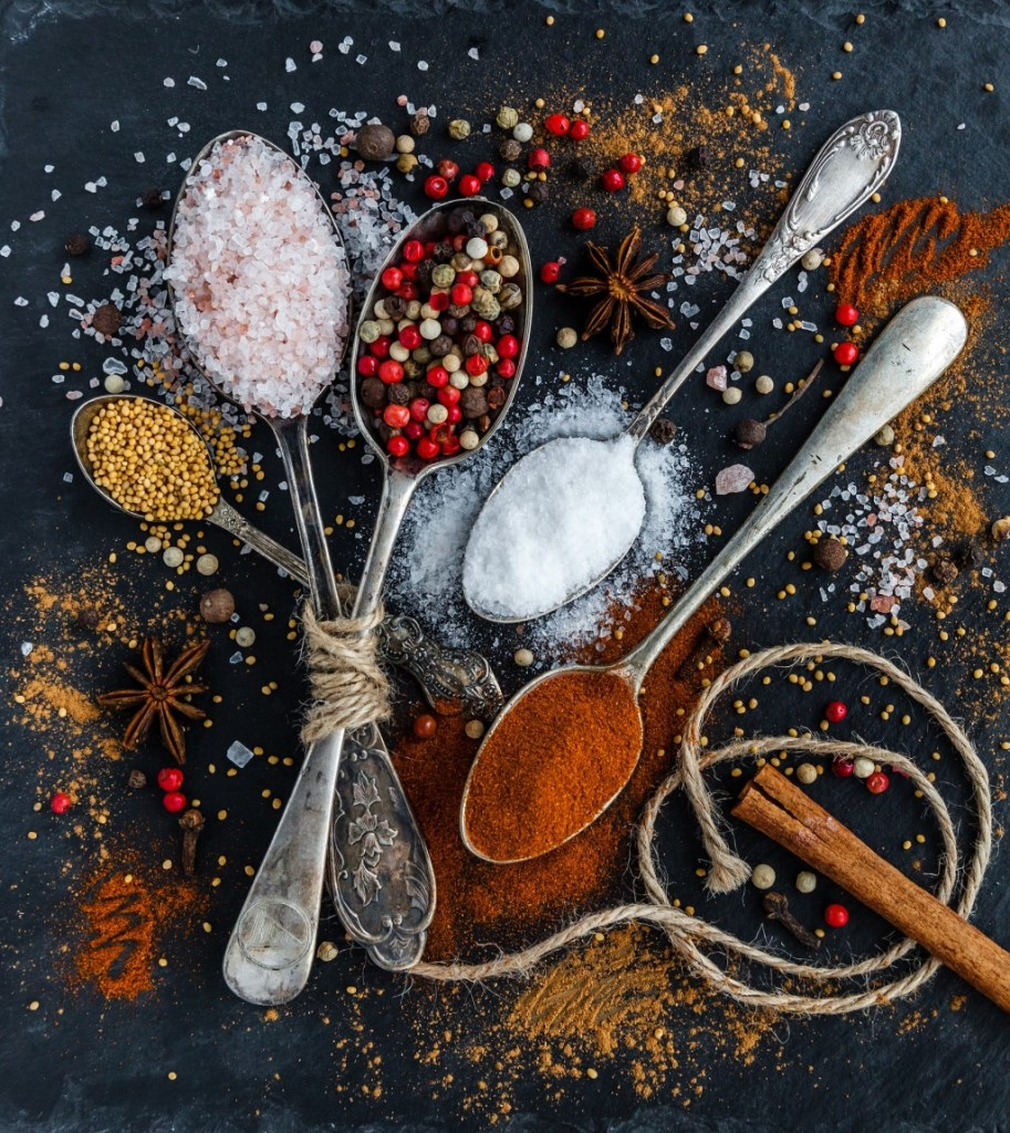 Spoons of colorful spices salts and peppercorns | photo by Daria Yakovleva | shop local for food and kitchen supplies in northern NJ | foodwithaview.com