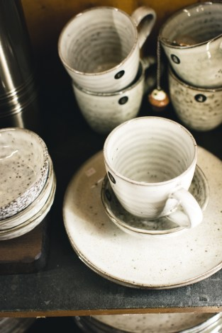 Stacks of white and gray teacups | photo by foodiesfeed | shop local for food and kitchen supplies in northern NJ | foodwithaview.com
