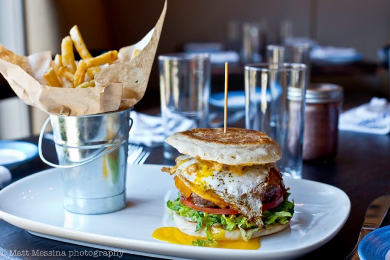 Burger with a fried egg and bucket of fries | south and pine restaurant | photo by matt messina | nj outdoor dining on foodwithaview.com