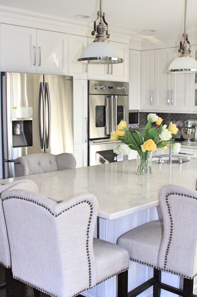 Stainless steel appliances in a white kitchen | kitchen renovation | a kitchen love story by foodwithaview.com