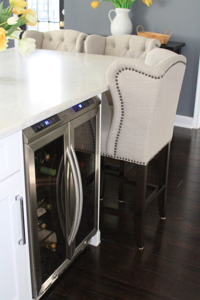Upholstered counter seating and a wine fridge | kitchen renovation | a kitchen love story by foodwithaview.com