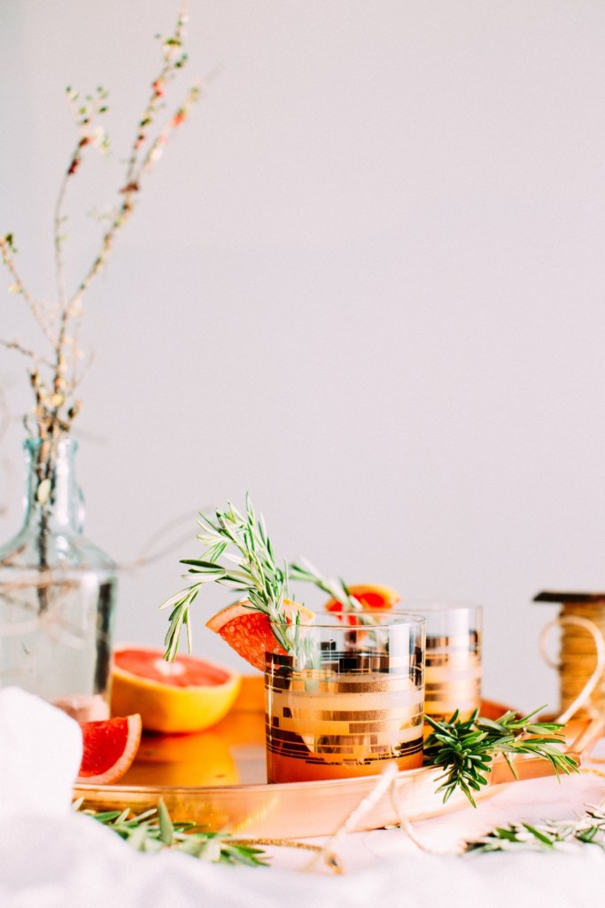 Grapefruit and rosemary in gold cocktail glasses | photo by Jennifer Pallian | summer cocktails with the drunken botanist | foodwithaview.com