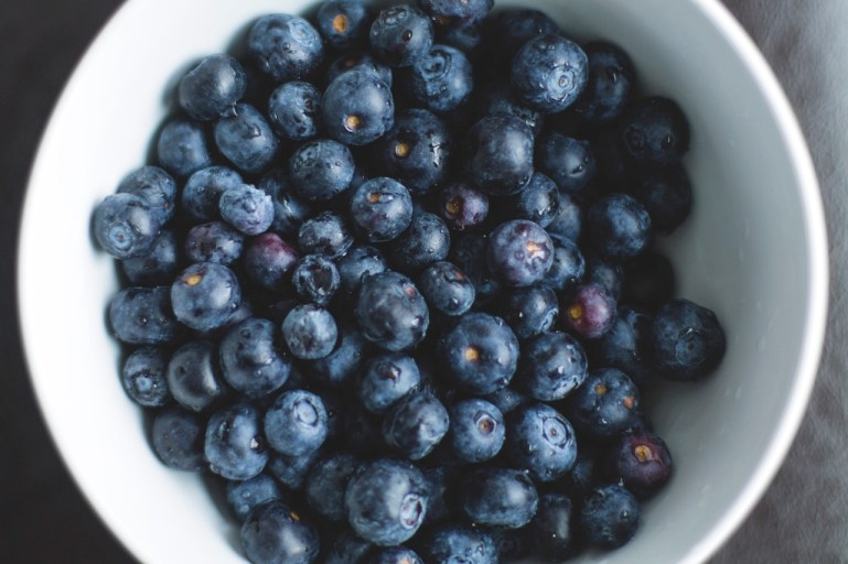 Blueberries in a white bowl | photo by Brandon Wilson | Fall parties and entertaining by foodwithaview.com