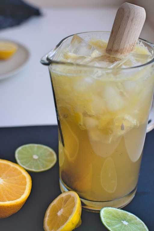 White sangria with oranges and limes in a clear pitcher | photo by foodiesfeed.com | Fall parties and entertaining on foodwithaview.com