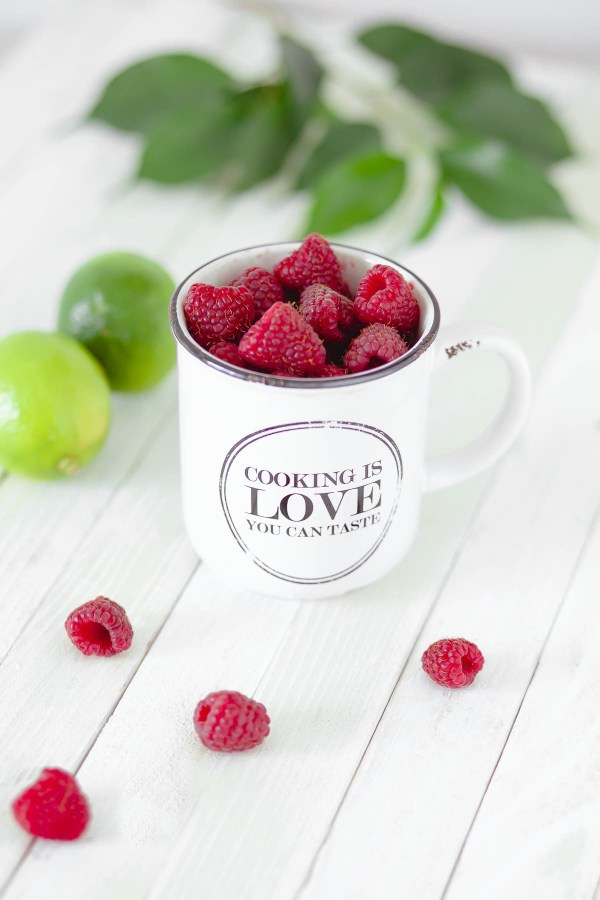 White mug reads Cooking is Love you can Taste | Filled with Raspberries | How a food blogger really eats | foodwithaview.com