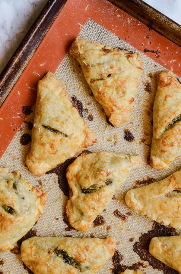 Spinach bacon artichoke hand pies fresh out of the oven | Recipe and photo courtesy of foodabovegold.com | Halloween party planning on foodwithaview.com
