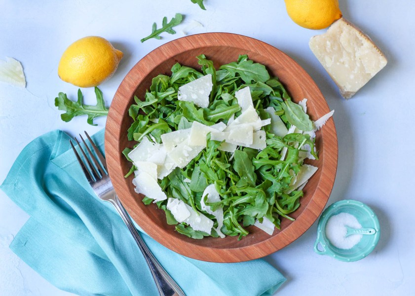 Arugula and parmesan salad in a wooden bowl | The best of Barefoot Contessa tips lessons and recipes | cooking and entertaining with foodwithaview.com