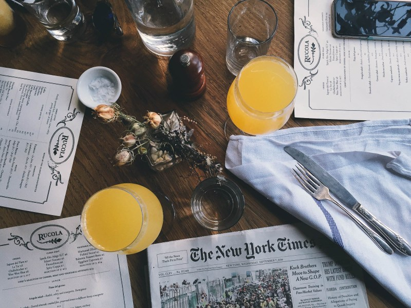 Reading the NYTImes over a restaurant brunch | Best NJ Brunch Restaurants on foodwithaview.com | photo by natalia ostashova