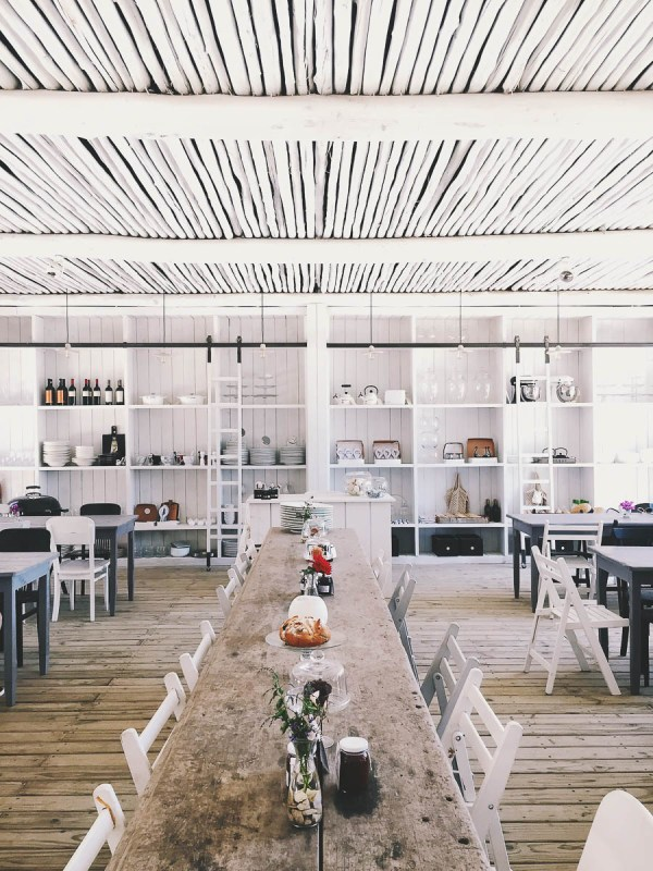 Beautiful whitewashed restaurant with rustic communal farm table seating | Tasting menus in NYC under $100 | NJ restaurants with tasting menus | photo by beno galetto | foodwithaview.com