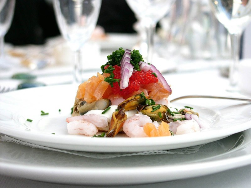 Seafood tasting course on a white plate | Tasting menus in NYC under $100 | NJ restaurants with tasting menus | foodwithaview.com
