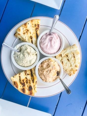Greek mezze platter with pita breads | EVOO + Lemon restaurant review | foodwithaview.com