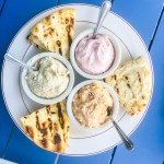 Greek mezze platter with pita breads | EVOO + Lemon restaurant review | foodwithaview.com