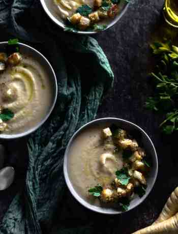 overhead shot of 3 bowls of roasted parsnip soup