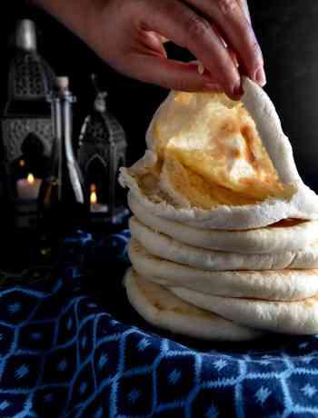 Exposing the pocket of a fresh-baked pita flatbread