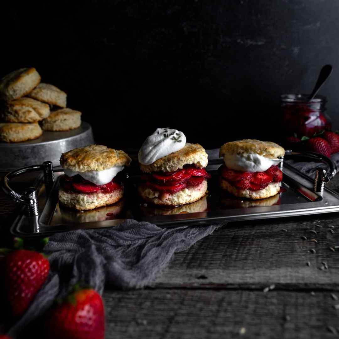 A platter of three strawberry shortcakes