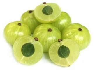 Amla fruits on a white background.
