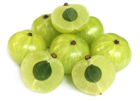 Amla fruits on a white background.