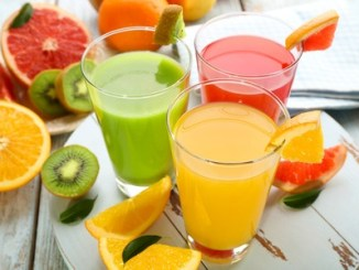 38614203 - fresh juices with fruits on wooden table