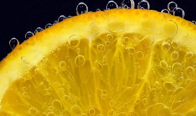 Orange slice on black background. pervaporation is used to recover orange juice aroma.