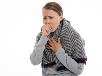 A woman who has a cough. essential oils for cough are widely considered.