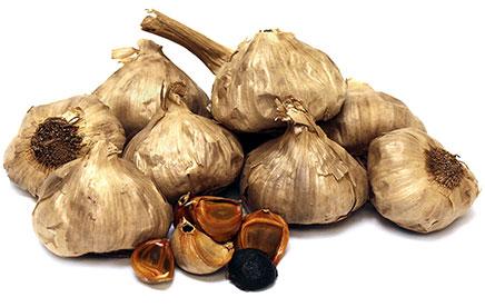 Black garlic bulbs on a white background