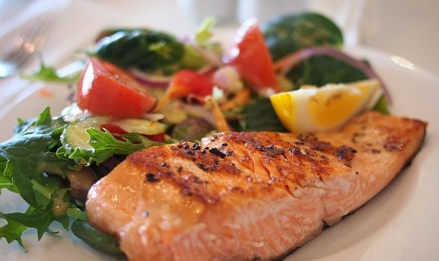 salmon on a plate. Fish consumption may prove highly beneficial for health.