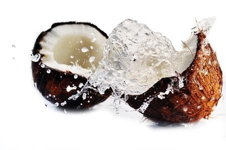 Coconut broken in two.