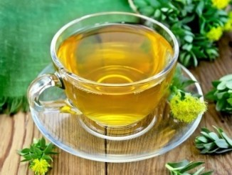 A cup of Golden Rod (Rhodiola) tea in a clear glass tea cup.
