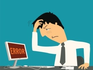 A cartoon showing a man holding his head and looking at a computer screen saying ERROR.