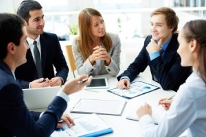 A group of young professionals in an office meeting.