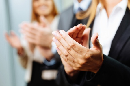 53954810 - close-up of business people clapping hands. business seminar. Copyright: baranq / 123RF Stock Photo