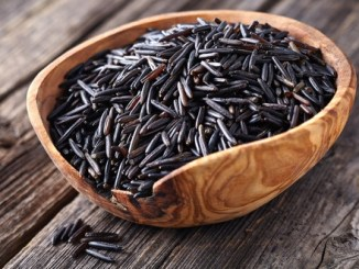 Wild rice in a wooden bowl.