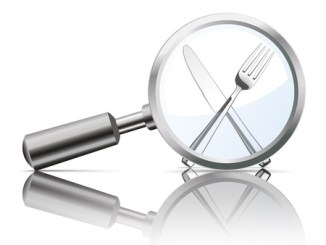 56044361 - loupe with knife and fork on the white background.
