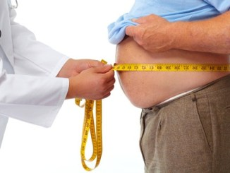 Doctor measuring obese man waist body fat. obesity and weight loss. May be he needs to be on the 5:2 Diet.