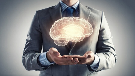 Close up of businessman holding digital image of brain in palms. Choline is an important factor in reducing risk of dementia.