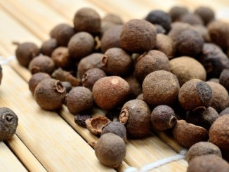 allspice on wooden table
