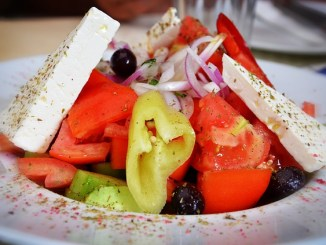 Mediterranean diet with cheese, tomato and pepper.