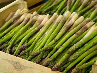 Asparagus spears in a box.
