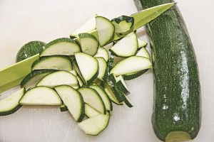Courgette sliced by a knife