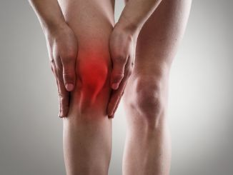 Tendon problems on woman leg indicated with red spot. joint inflammation concept.