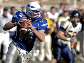 An American footballer Quarterback about to make a throw.