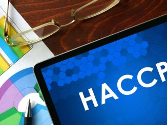 HACCP on a blue screen with other pictorials and pair of glasses.