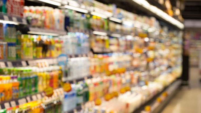 Supermarket, blur view of beverage product on refrigerator shelves in supermarket