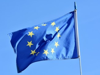 The European Union flag waving in the wind.