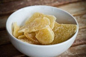 Crystallized ginger in a white bowl.