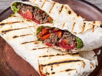 Homemade tasty burritos with vegetables and beef