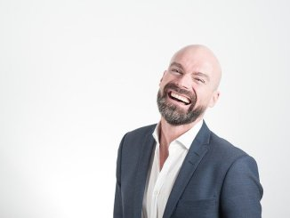 Bald man with beard. Does not give a toss about hair loss. Seems really happy !