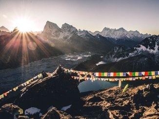himalayan mountains with sun just poking through.
